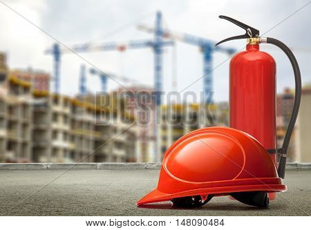 Fire Extinguisher And Helmet On Buildings And Cranes Background