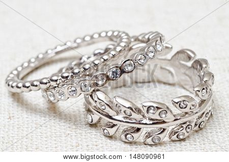 Assorted silver rings with crystals in arrangement