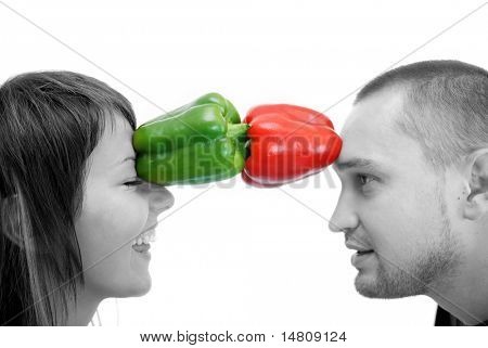 happy couple with pepper vegetable isolated