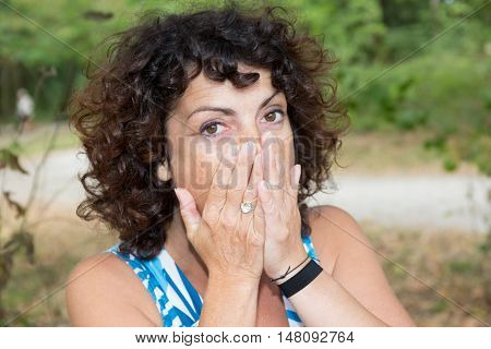 Surprised Woman With Hands Over Her Mouth Outdoor