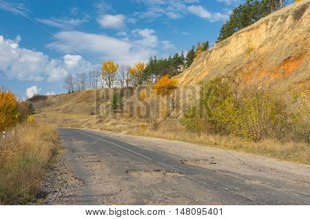 Abandoned ruined rural road in central Ukraine at fall season
