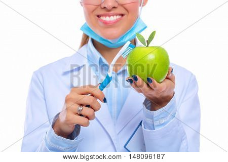 Dentist medical doctor woman hold green fresh apple in hand and tooth brush