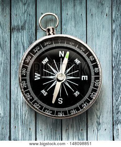 Black Compass On Wooden Background