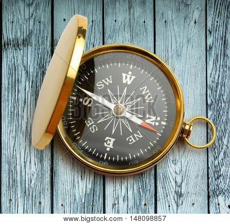 Golden Vintage Compass On Wood