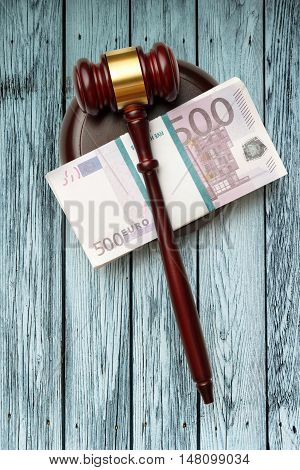 Wooden Judge's Gavel And Money