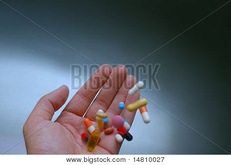 pills in human hand