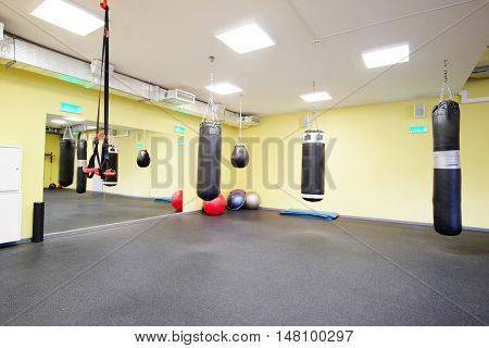 Interior of a fitness hall with punching bags