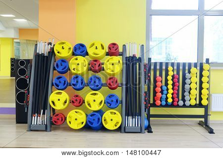 Interior of a fitness hall with dumbbells