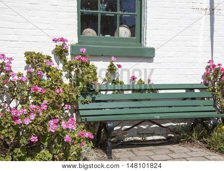 The little bench surrounded by flowers on a main street of historic Richmond town (Tasmania).