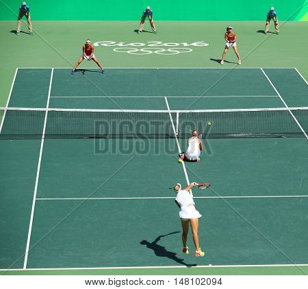 RIO DE JANEIRO, BRAZIL - AUGUST 14, 2016:E. Makarova and E. Vesnina of Russia(in white) and T. Bacsinszky and M. Hingis of Switzerland in action during women's doubles final  of the Rio 2016 Olympics