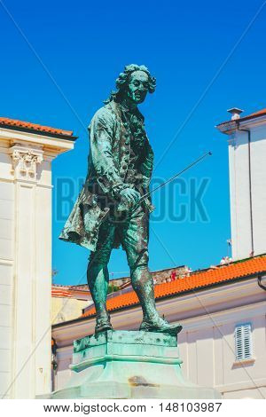 PIRAN SLOVENIA - AUGUST 27 2016: Statue of violinist and composer Giuseppe Tartini on the Tartini Square in Piran Slovenia