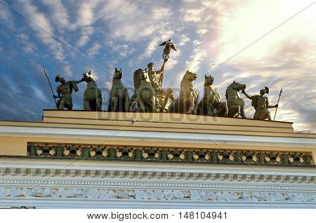 St Petersburg, Russia - architecture landscape. Sculptural group named Chariot of Fame lit by sunlight on the roof of the Headquarters in St Petersburg Russia. Architecture view of St Petersburg landmark.