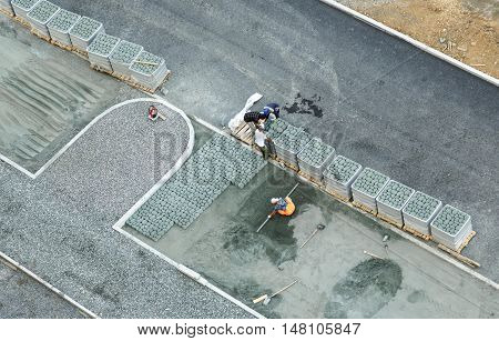 Workers Constructing Pavement