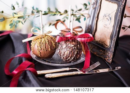 apples dipped in chocolate on a stick in still life