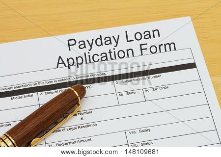Applying for a Payday Loan Payday loan application form with a pen on a desk