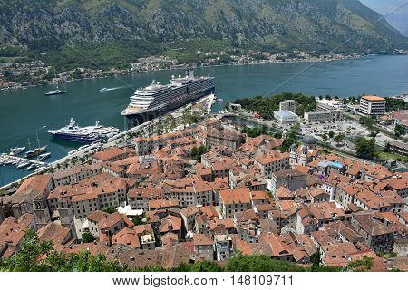 Kotor, Montenegro - June 26th 2016. The historic old town of Kotor is visited by two huge cruise ships at the start of the tourist season.