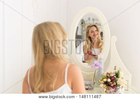 Beautiful Blonde Woman Looking In Mirror Brush Hair, Young Girl Morning Happy Smiling Back Rear View