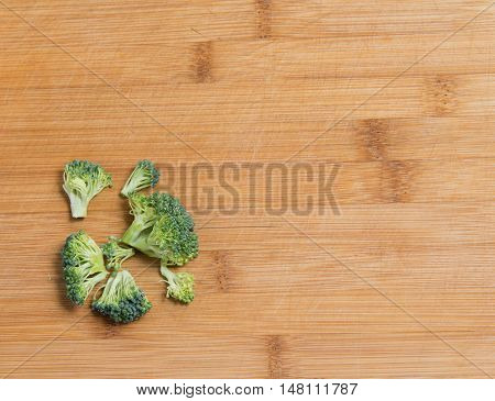 Fresh Broccoli Solated On A Wooden Background