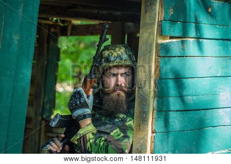 Portrait Of Soldier In Camouflage