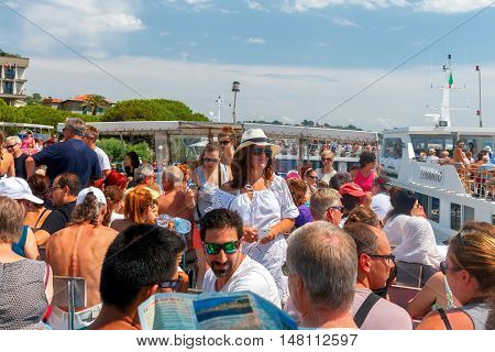 Portovenere. Italy - July 24, 2016: Many tourists on the decks of pleasure boats in Portovenere. Boat trips are very popular among tourists on the coast. Liguria. Cinque Terre. Italy