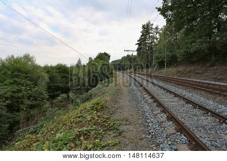 railway track in the middle of nature