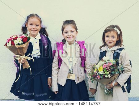 Moscow Russia - September 1 2016: Unidentified girls with flowers bouquet on solemn meeting of first grade kids called the Day of Knowledge signify the beginning of school year.