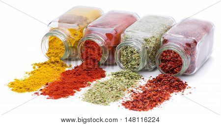Spices pour out from glass jars. Spices for recipes of dishes.