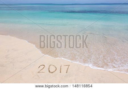 Happy New Year 2017 creative on the beach