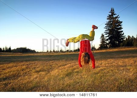 Girl doing exercise in nature