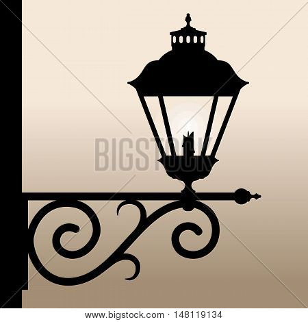 Vintage lantern. Silhouette of an old lantern with a candle. Vector illustration.