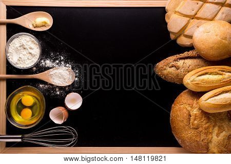 Ingredients and utensils for bakery black background