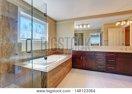 Luxury Bathroom Interior With Large Vanity Cabinet, Glass Cabin Shower And White Bath Tub.