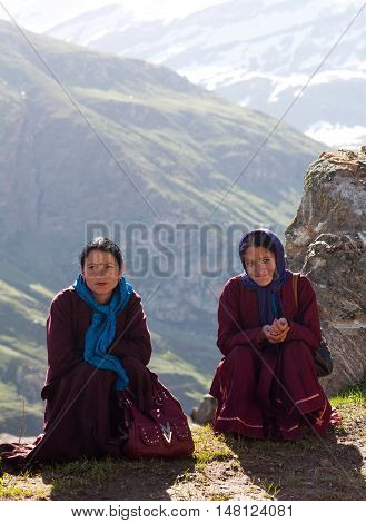 LADAKH, INDIA - JUNE 9, 2012: Women poses for a photo on the road from Manali to Leh in Ladakh, Jammu and Kashmir State.