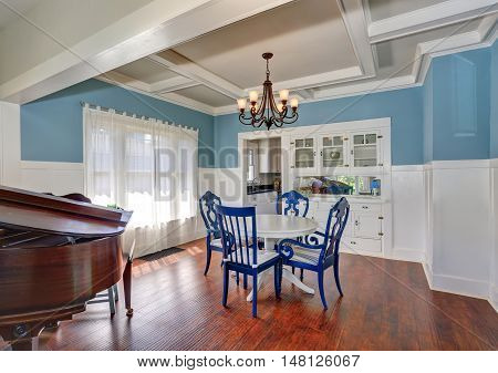 Blue And White Dining Area With Nice Table Set.