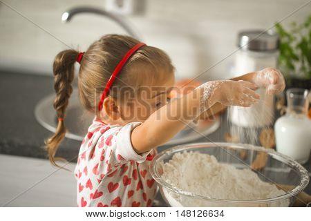 Beautiful Little Girl Baker On Kitchen
