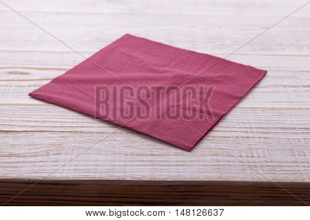 paper napkin on old wooden table close up. place for text