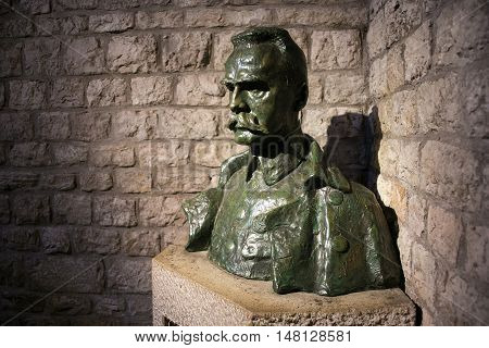 POLAND, KRAKOW - MAY 27, 2016: Bust of Jozef Pilsudski near his grave in Wawel castle. Jozef Pilsudski was a polish statesman, Chief of State (1918-22),