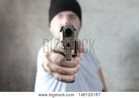 Armed Robber Pointing The Gun At The Target