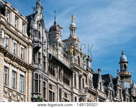 Facades of landmark buildings along Meir street in Antwerp, Belgium with ornaments and statues