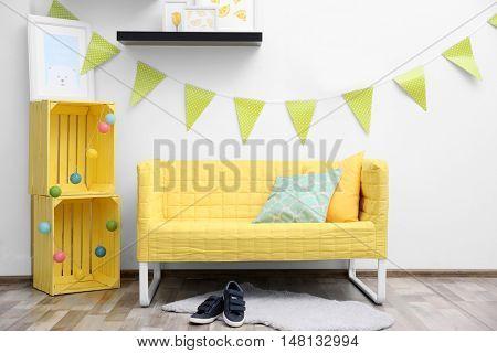Modern interior design with yellow sofa