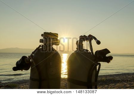 Two tanks on a sea shore. Side mount diving