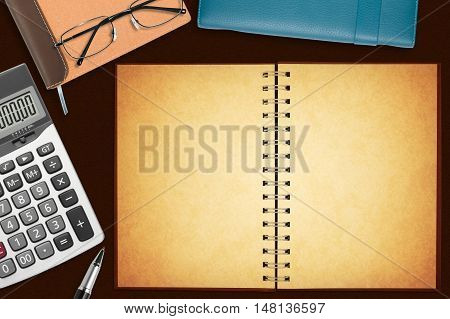 blank old notebook with stationery on the desk for your text