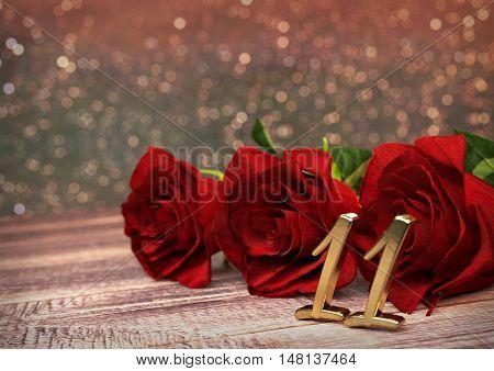 birthday concept with red roses on wooden desk. 3D render - eleventh birthday. 11th
