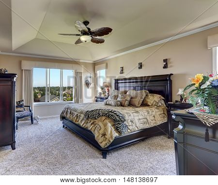 Luxury Interior Of Master Bedroom With Black Furniture