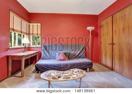 Lovely Red Sitting Room With Gray Sofa And Coffee Table