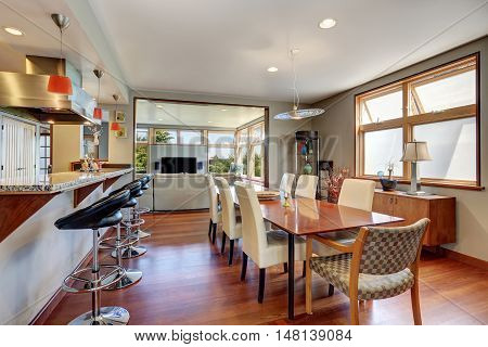 Large Wooden Dining Table With White Chairs In Cozy House