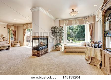 Large Master Bedroom In Luxury Home With Doors To Balcony.