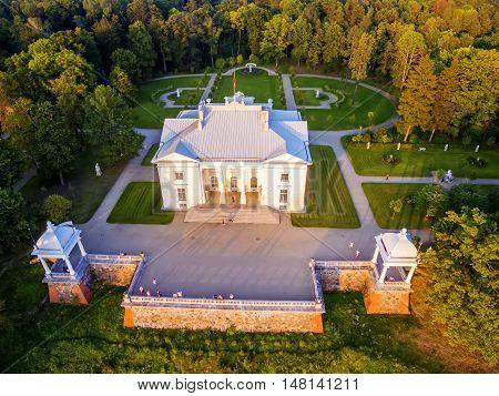 Trakai, Lithuania: Aerial UAV top view of Uzutrakis Palace in the autumn sunset