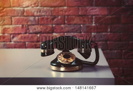 Old telephone on the table in room
