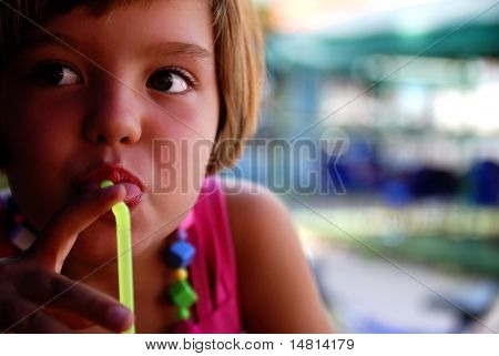 Cute little girl enjoying cold drink